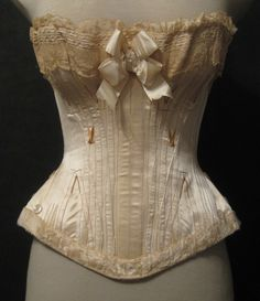 [Meg, this lady's corsetry board is full of interesting antique and current styles.] Parisian wedding corset by Madame Pollan, 46 Rue de Lafayette, c. Corset Vintage, Victorian Corset, Vintage Lingerie, 1880s Fashion, Victorian Fashion, Vintage Fashion, Wedding Corset, Steampunk Wedding, Rose Bonbon