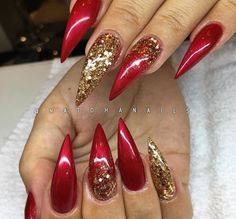 Cranberry stiletto nails with gold accents