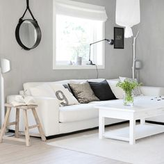#interior #decor #styling #livingroom #lounge #white #grey #Jielde #cushions