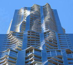 Residential building designed by Frank Gehry in New York. It's amazing that Gehry can vomit wavy protrusions on the side of a facade and manage to maintain his credibility as an architect. Architecture 101, Futuristic Architecture, Beautiful Architecture, Contemporary Architecture, Frank Gehry, Interesting Buildings, Amazing Buildings, Famous Buildings, Building A House