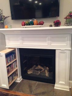 DVD storage in fireplace