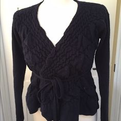 Anthropologie, Sparrow, navy wrap cardigan A beautiful textured ruffle sweater in navy blue. Can be worn open and tied in the back or wrapped and tied in front. A stretchy and warm sweater. Size Large but fits more like a Small/Medium. Anthropologie Sweaters Cardigans