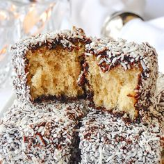 Lamingtons! a.k.a. Chocolate Coconut Cake Squares, homemade white cake dipped in a decadent chocolate syrup and then rolled in coconut. An Australian fave!