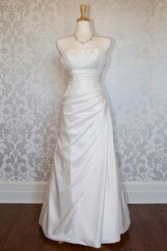 Simple strapless with empire waist taffeta gown Not into the top but love the rest!
