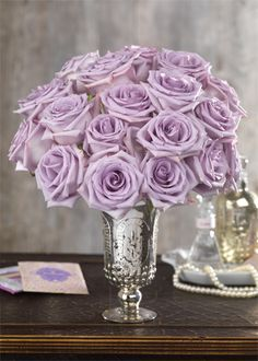 Our Parisian Roses - the lavender rose is often a sign of enchantment and 'love at first sight'. Used to express romantic feelings and intentions.  #calyxflowers #PurpleRoses   #LavenderRoses