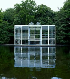 "Wiek Röling | Floating statue pavilion, Sonsbeek, 1986. ""The pavilion was proportioned with a height equal to half the breadth, so that, together with its reflection in the water, the pavilion visually formed a perfect floating cube.""  Photo Pieter Boersma"