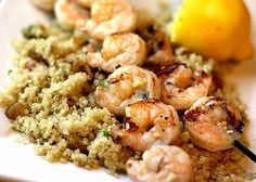 Grilled Garlic Shrimp with Quinoa. Grilled Garlic Shrimp on a bed of Quinoa with Garlic Nuts and Raisins is a perfect light dinner for summertime! Clean Eating Recipes, Healthy Eating, Cooking Recipes, Healthy Recipes, Healthy Foods, Yummy Recipes, Seafood Dishes, Seafood Recipes, Dinner Recipes