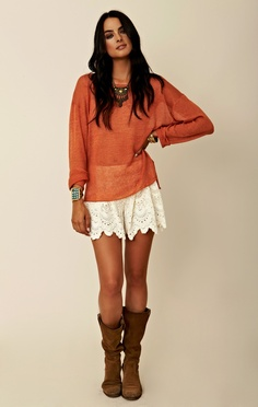 Pair a slouchy sweater with lace shorts and cowboy boots. Add a statement necklace, and voila, you're done