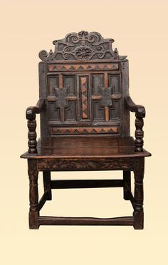 Scottish 16th century joined oak and inlaid armchair of small proportions, circa 1580. The twin panel back rest with geometric applied mouldings and three separate inlaid holly and bog oak panels, above the ornately carved and typically English Elizabethan designed cresting rail.