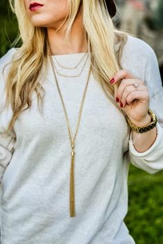 layered gold necklaces + burgundy lip & nails