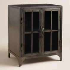 For guest room-Expand surface area and storage space with our symmetrical, clean-lined side table featuring two shelves behind paned glass cabinet doors.