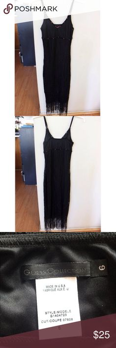 "Vintage guess collection black fringe tassel dress A nice vintage Guess Collection black fringe maxi dress in a size 6. Has an outer crochet layer with tassels at the ends. Has little pink roses and pink rhinestone details. Has black velvet overlay on the straps and around the bust. Dry clean only. Some of the velvet on the right strap has rubbed off (see the last picture), otherwise is in good vintage condition, selling as is.  Armpit to armpit: 13"", total length (shoulder to end of…"