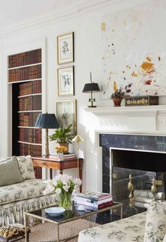 Elegant seating area reveals a hidden door with a faux book fronts.