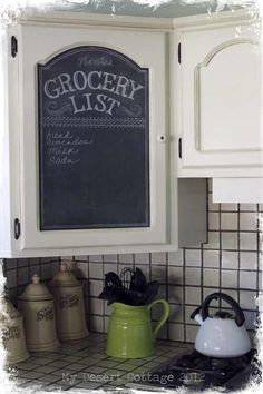 Cupboard door grocery shopping list! Super easy! Remove the door from the cupboard, use blue painter's tape to tape off the area you want painted from the areas you DON'T want painted, and use store bought or make-your-own chalkboard paint! Let dry and voila! Your very own cupboard chalkboard shopping list!