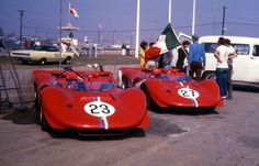 The 2 350 CanAms' at rest, Riverside paddock 1967. #23 Amon #27 Williams 8th and DNF…'0858′ and '0860' or…'0860′ and '0858' take your guess.