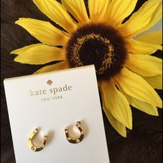 Kate Spade horseshoe and rhinestone earrings Dainty and playful! These sparkly earrings are sure to bring good luck! Brand-new with tags kate spade Jewelry Earrings