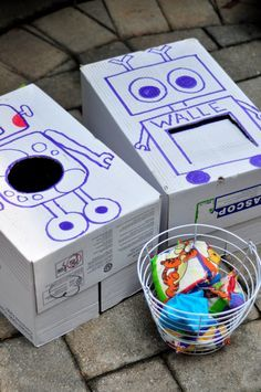 """robot birthday party games robot bean bag toss. Or make the boxes into whatever theme you want to use. We may end up with some sort of superhero """"feed"""" box"""