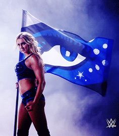 The queen of wwe Charlotte Flair looking powerful.