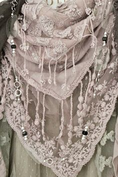 For some reason I'm liking this bohemian style lately... messy lace and bits of shiny stuff...