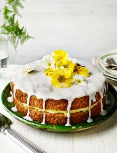 Courgette and lemon drizzle cake with crystallised primroses