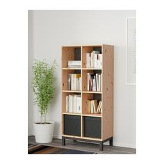NORNÄS Bookcase  - IKEA.  We could put 3 of these in laundry.  Maybe put doors on them.