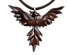 This original design reversible wooden Pegasus pendant is artfully hand carved in Honduran Rosewood, an exotic hardwood highly diverse in colors and patterns, making this pendant unique and one of a kind.  ★ This particular exotic wood tends to darken over time. By the time you will receive this pendant the wood might have settled into darker reddish-brown tones. The colors look more vivid in bright natural light versus artificial light, where the tones are a little darker and more subdued…
