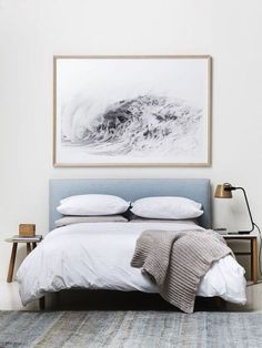 Gorgeous simple bedroom decor: upholstered headboard, mismatching night stands and lamp, neutral bedding and large framed print. Are you looking for unique and beautiful art photo prints to create your gallery wall... Visit bx3foto.etsy.com