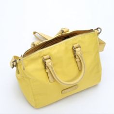 """Liebeskind Yellow Nylon Convertible Tote Bag Brand new, never used. Berlin designer , Liebeskind, delivers sleek and stylish handbags that you'll continuously adore. Leather Trimmed Nylon. Buckle Detail At Handles. Top Zip Closure Dual 13"""" Rounded Leather Top Handles With 5""""Drop; Clip Removable And Adjustable 42½"""" Flat Leather Shoulder Strap With 23"""" Drop Canvas Lining With Side Zip Pocket, Patch Pocket, And Two Slip pockets Liebeskind Bags Shoulder Bags"""
