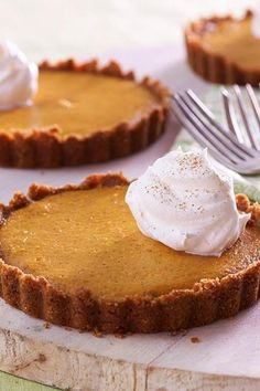 Offer these individual tarts as a reduced-sugar alternative to pumpkin pie at your next holiday meal.#thanksgiving #thankgivingrecipes #thanksgivingdesserts