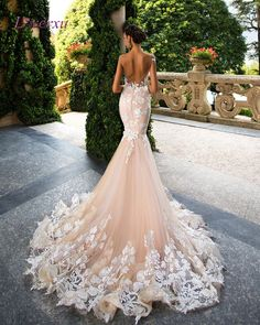 Loverxu Romantic Scoop Neck Backless Princess Mermaid Wedding Dress 2017 Gorgeous Appliques Robe De Mariage Bride Gown Plus Size. I absolute love the champagne color mixed with the white appliqued lace. It's one of those that will be 25% off at checkout. Don't forget to sign up for our newsletter so you are always in the know on what's coming in and going out.
