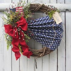 Patriotic Wreath, Summer Wreath, 4th of July Decoration, Americana Wreath Festive 4th of July Wreath with patriotic star, lichen moss, burlap bow, star fabric material & grass & greenery, berries, flag on grapevine wreath. Wreath dimension: 20 inches wide; 18 tall: 4.5 inches deep.