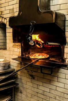 The large, white-tiled oven at Pizza Moto has been converted from coal to wood. (Photo: Krista Schlueter for The New York Times) La Trattoria, S Brick, Restaurant New York, Pizza Party, Calzone, Wood Photo, Large White, Oven, Times