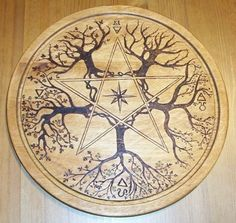 Pentacle Your altar pentacle can be anything from a simple pendant, to a large table-top platen. The pentacle represents Earth, and you use it to cleanse or consecrate other items on your altar. Typical pentacles are metal, ceramic or carved from wood. Wicca Witchcraft, Pagan Witch, Magick, Witches, Pentacle, Book Of Shadows, Pyrography, Occult, Wood Art