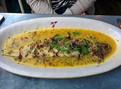 Whole baked lemon sole with a nutty seed crust finished with butter and zesty orange sauce @ Jamie's Italian