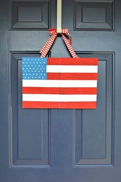 Wooden shims or even paint stirrers are the perfect base for this brightly painted flag that you can hang on your door.