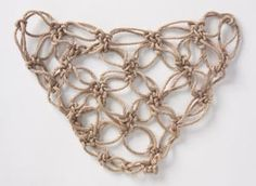 Solomon's knot stitch. Good for decorative pieces like accessory scarves.