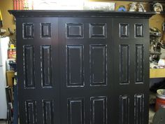 King size headboard made with three doors satin black and white distressed finish by Vintage Headboards.