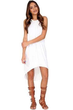 White sleeveless high-low dress. This basic dress will definitely help you beat the summer heat! Wear with gladiators for a casual look or throw on a bathing suit and use this dress as a cover-up for a day at the beach.