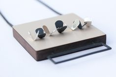 Emily Kidson. Necklace: wood, laminate, silver and oxidised silver