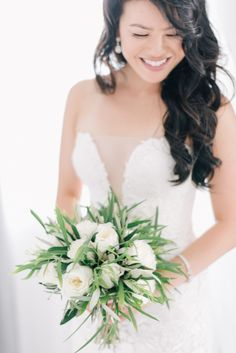 Rose and greenery wedding bouquet: Photography : Ben Yew Photography + Film Read More on SMP: http://www.stylemepretty.com/2017/03/15/santorini-modern-minimalist-wedding/