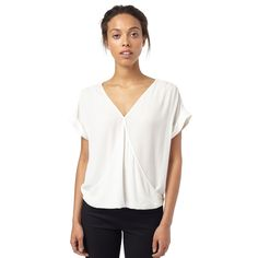 Buy the Jess Wrap Blouse at Oliver Bonas. Enjoy free worldwide standard delivery for orders over £50.