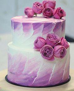 Cake brush technique white purple buttercream two tier fresh flowers