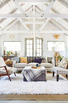 farmhouse interior white living room with high beamed ceilings