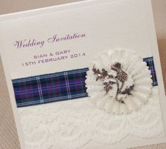 Handmade Pocketfold Wedding Invitation made from pearlised card, trimmed with your choice of tartan ribbon, lace and embellished with a 3d rosette and metal thistle embellishment