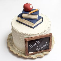 ** INCLUDES ** 1 stack of 2 books in cover color of your choice, a bitten apple and pencil on top, and a chalk board with a message of your Teachers Day Cake, Teacher Cakes, Royal Icing Cookies, Cake Cookies, Cupcake Cakes, Cupcakes, Chalkboard Cake, Satin Ice Fondant, School Cake