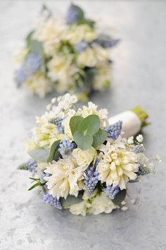 Spring scented bridesmaids bouquets in the most gorgeous ivory and pale blue. Filled with muscari and hyacinths www.greenparlour.com