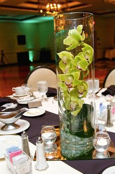 Tall, enclosed orchid centerpiece.