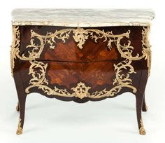 Found on EstateSales.NET: A LOUIS XV-STYLE MAHOGANY AND FRUITWOOD MARQUETRY AND GILT BRONZE MOUNTED BOMBÉ COMMODECirca 190032-3/4 x 42-1/2 x 20-1/4 inches (83.2 x 108.0 x 51.4 cm)