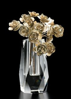 4 1/4 in Faceted Crystal Bud Vase CRYSTAL DOES NOT HAVE TO BE BORING. WE LOVE THE MODERN AND RANDOM SHAPE OF THIS FACETED CRYSTAL BUD VASE.