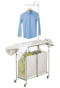 This multipurpose laundry station features a built in 43 L x 14 W ironing board, dual laundry sorter, iron rest, and hanging bar. The thick foam pad and heat resistant, cotton/canvas cover provide a smooth ironing surface every time. Laundry Room Storage, Laundry Hamper, Diy Storage, Storage Ideas, Laundry Bags, Laundry Closet, Laundry Rooms, Small Laundry, Storage Shelves